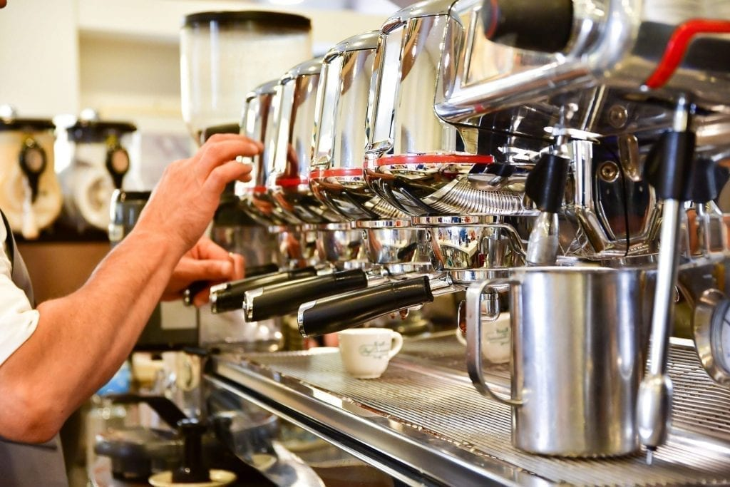 Large espresso machine demonstrating coffee in Italy