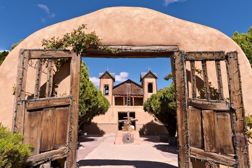 Chimayo Pueblo Church in northern New Mexico, a popular pilgrimage site and a stop on one of the best road trips in America