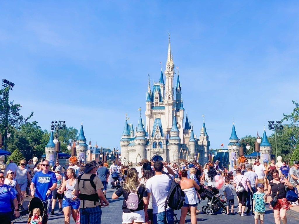 Magic Kingdom Castle in Florida with a crowd in front of it--Disney World is absolutely one of the top weekend getaways in the south