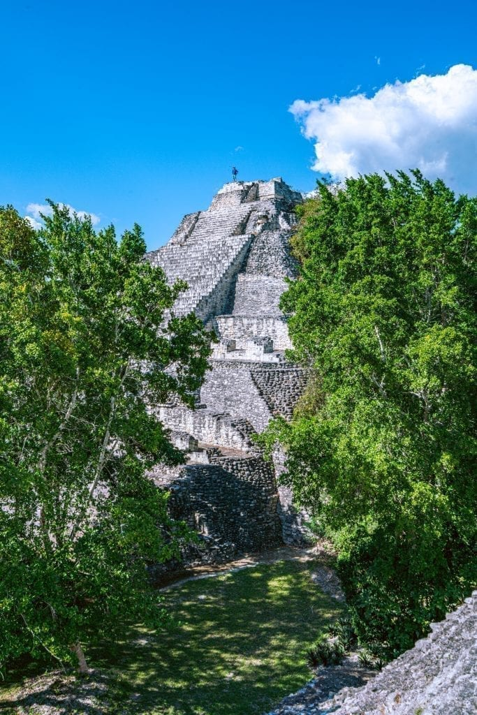 One of the tallest pyramids in Becan Mexico peeking up above the trees