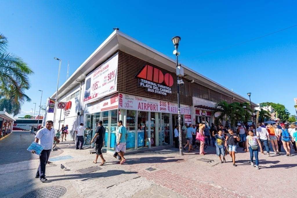 Exterior of ADO bus station on 5th Avenue Playa del Carmen--taking the ADO buses is one of our top tips for traveling to Mexico