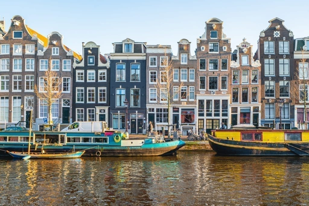 Canal as seen one day in Amsterdam, with houseboats in front of the typical Dutch houses