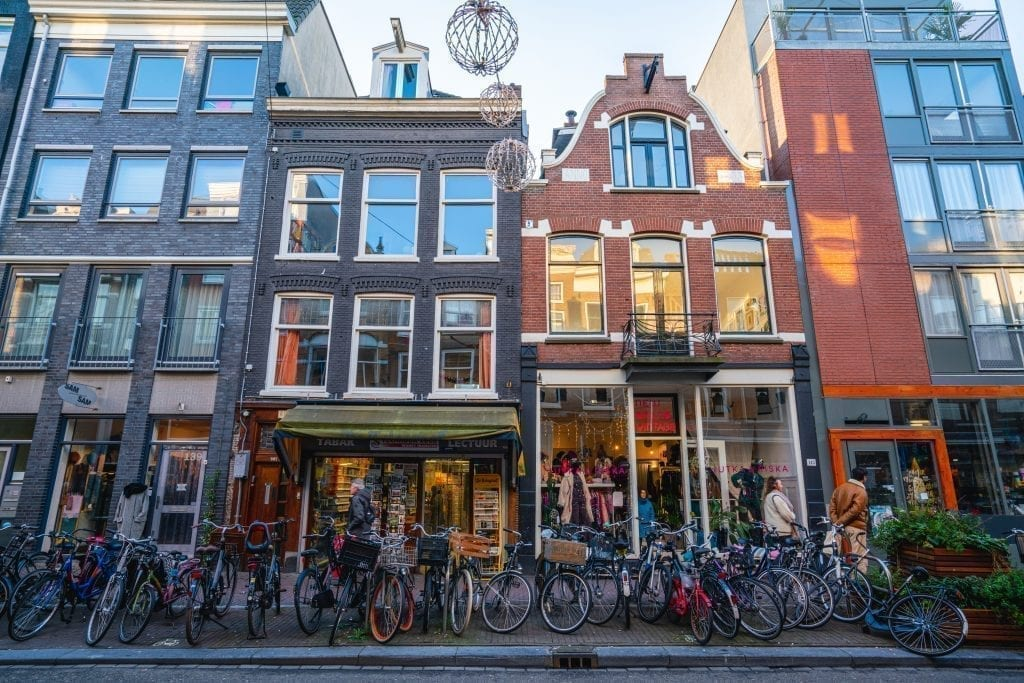 Boutiques in Amsterdam with bikes parked in front of them