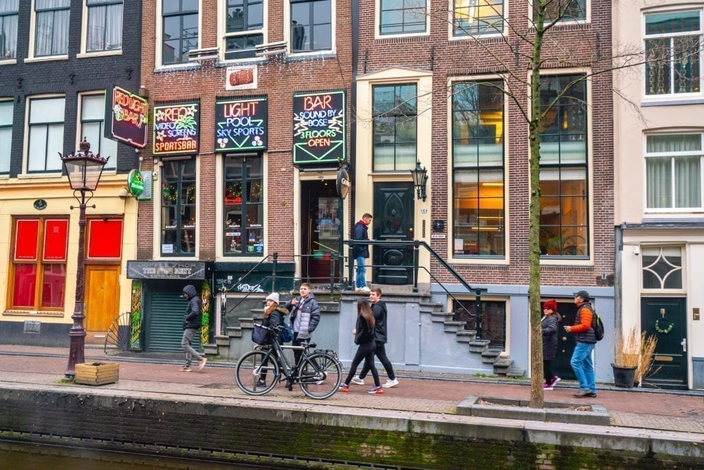 people walking through red light district in amsterdam netherlands