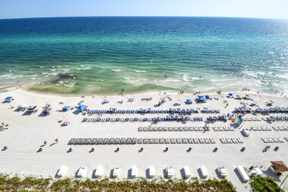 Panama City Beach in Florida as seen from above with beach chairs laid out. PCB is a classic weekend trip in the south
