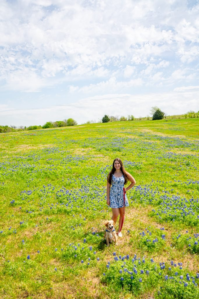 kate storm and ranger storm in a bluebonnet field in ennis, one of the best texas weekend trips