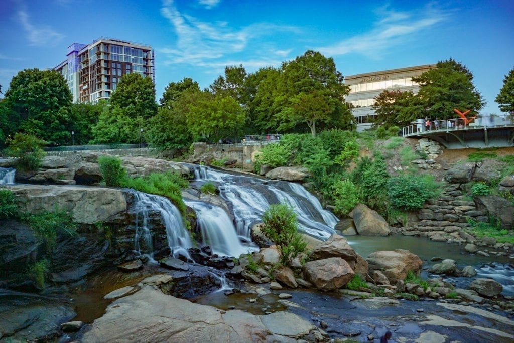 Downtown Greenville South Carolina, an up and coming southern weekend getaway, with the river in the foreground of the photo