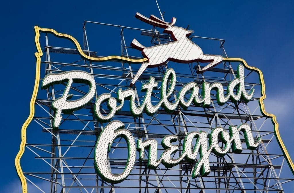 "Photo of steal sign stating ""portland oregon"" in front of a blue sky, a must-see during 3 days in portland or"