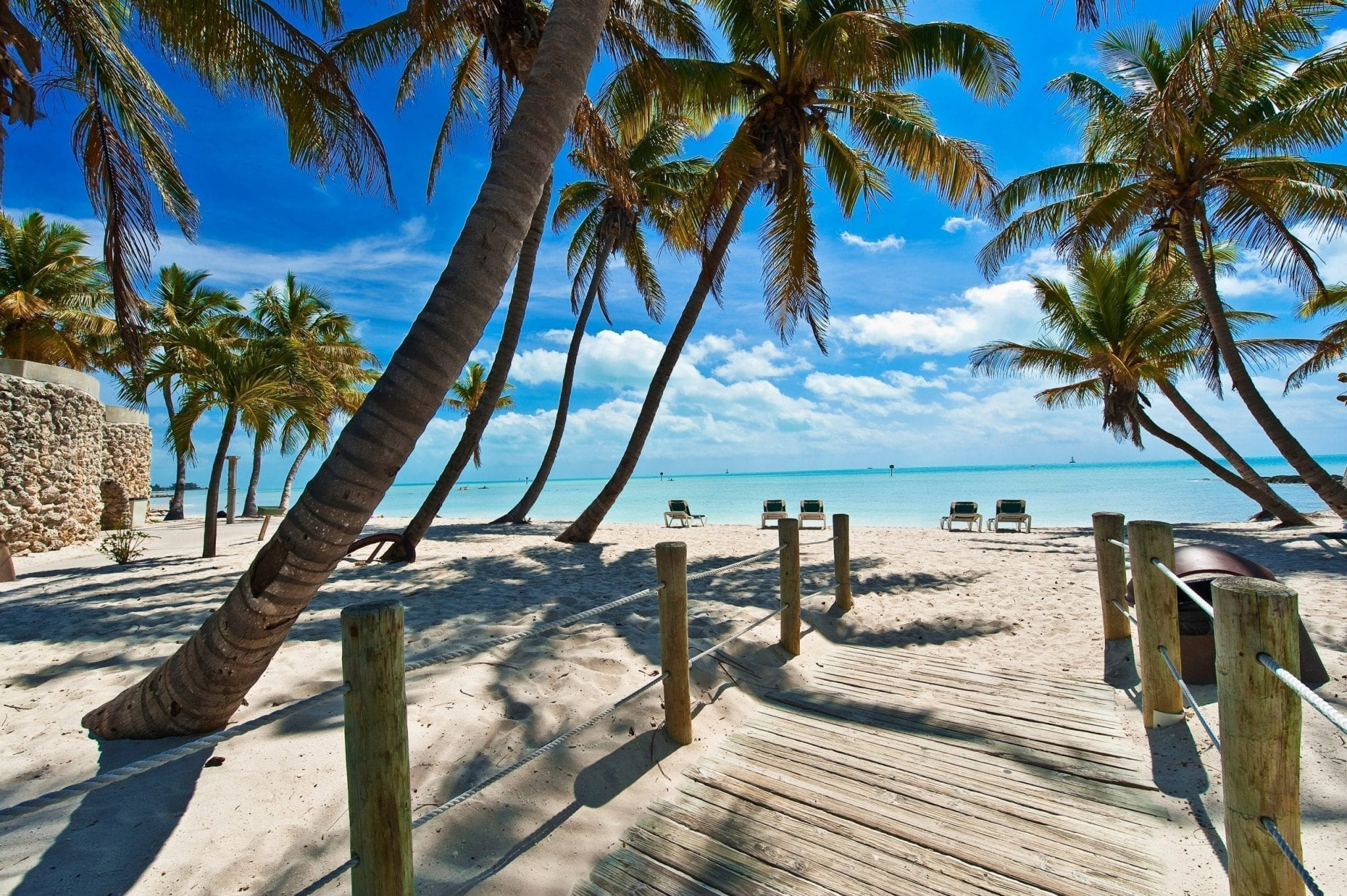 Palm-tree lined path leading to Caribbean Sea beach in Key West Florida, one of the best southern weekend getaways