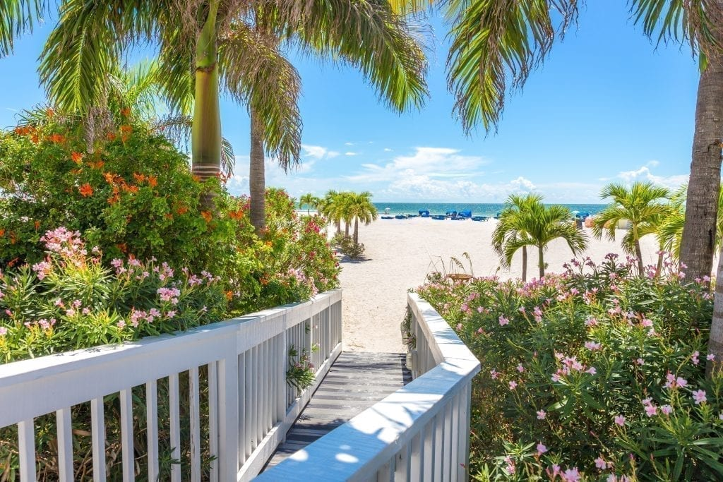 White fenced path leading to beach in St Petersburg Florida, one of the best weekend getaways southern usa