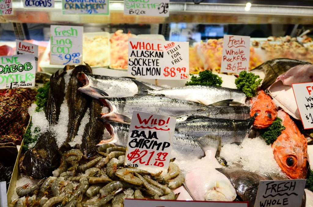 fresh seafood for sale at pikes place market, one of the best places to visit seattle weekend getaway