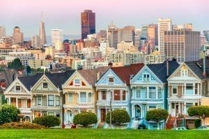 Painted ladies of San Francisco at sunset with skyline in the background, one of the best places to visit when spending 3 days in San Francisco CA