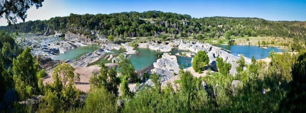 Panoramic View of Pedernales Falls Texas as seen from above on a sunny day, one of the best places to visit in Texas