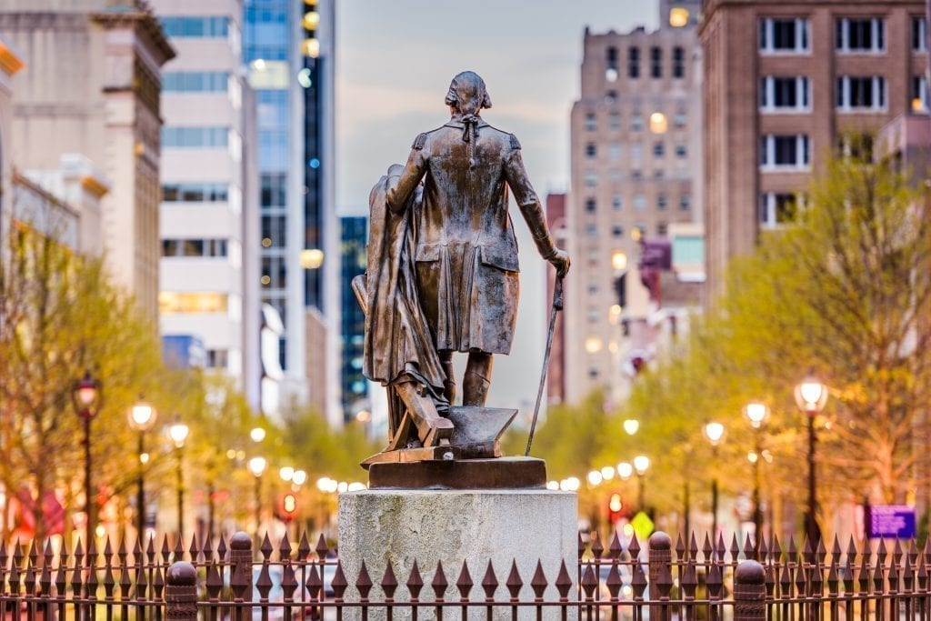 Statue of George Washington overlooking the city of Raleigh NC at sunset