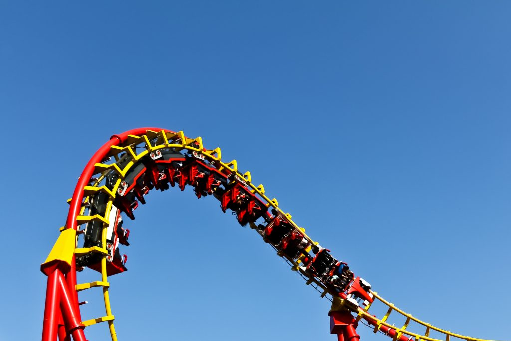 red and yellow roller coaster upside down