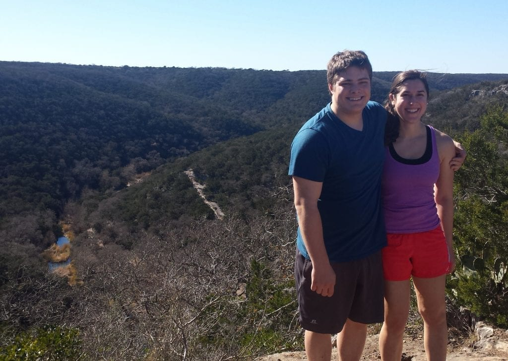 Jeremy Storm and Kate Storm hiking in Lost Maples State Park, one of the best day trips from San Antonio TX