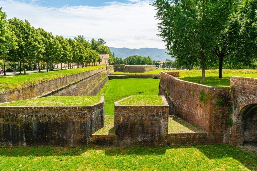 view of a park in lucca italy along the city walls