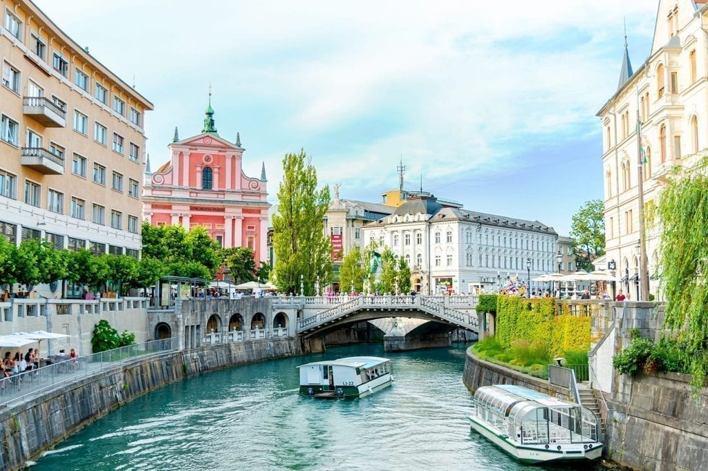 River in Ljubljana with Preseren Square visible in the background. Ljubljana is the first stop on this 7 days in Slovenia itinerary