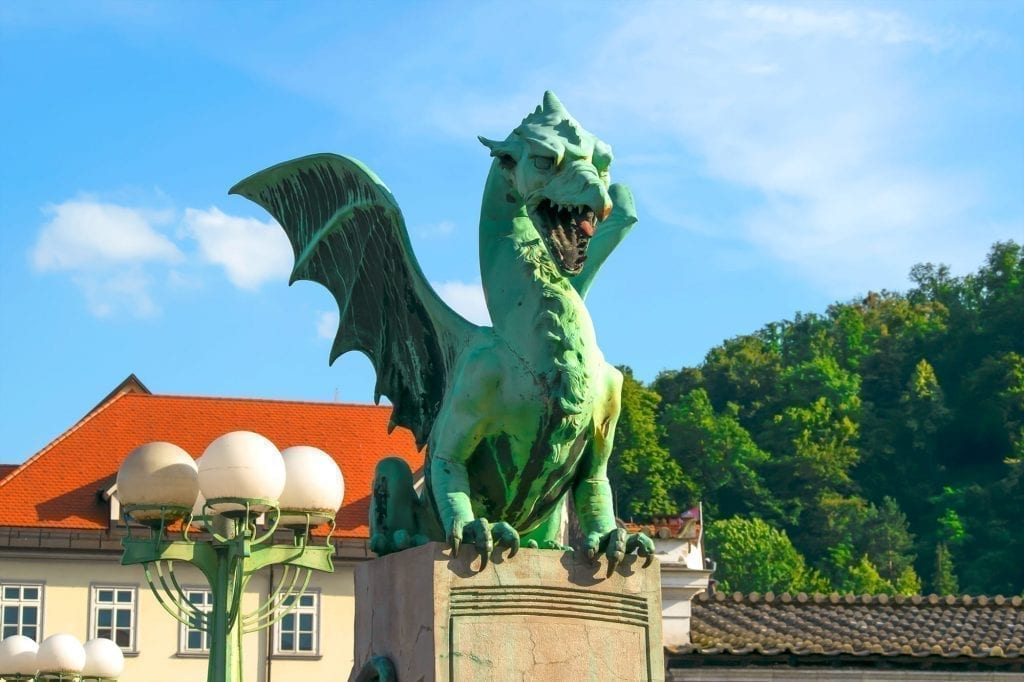 Green dragon as seen on Dragon Bridge in Ljubljana Slovenia, one of the best places to visit in Slovenia