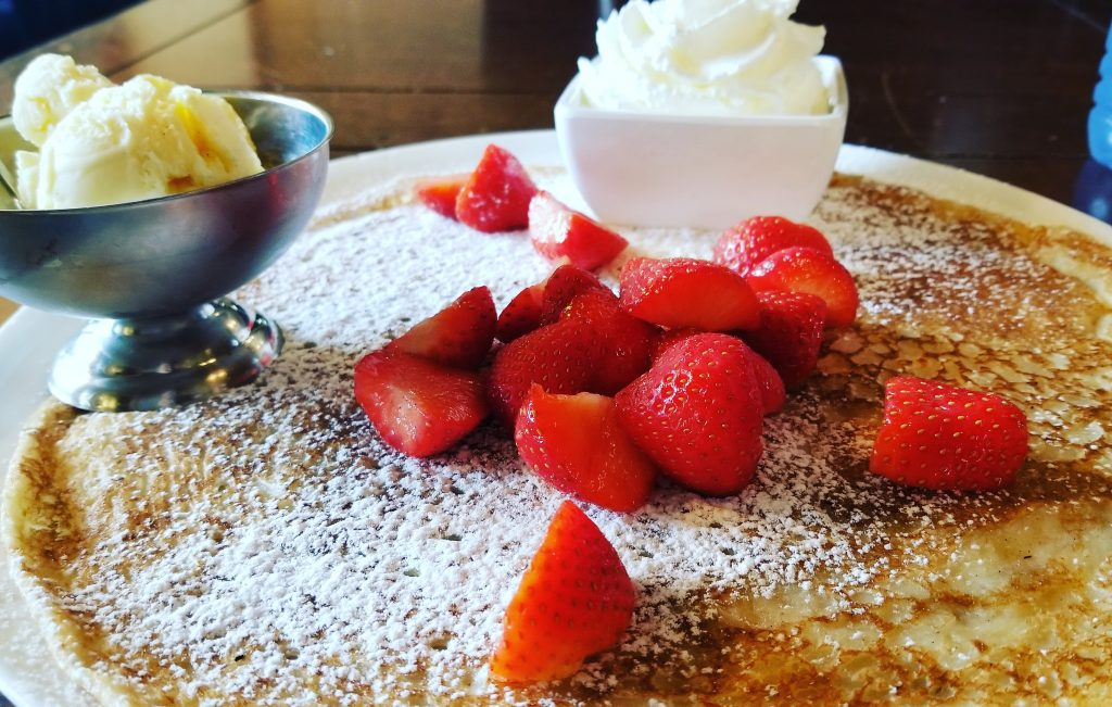 dutch pancake topped with strawberries