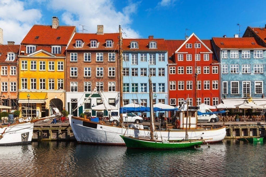 Nyhavn Harbor on a sunny day in Copenhagen Denmark, one of the best cities to visit in Europe