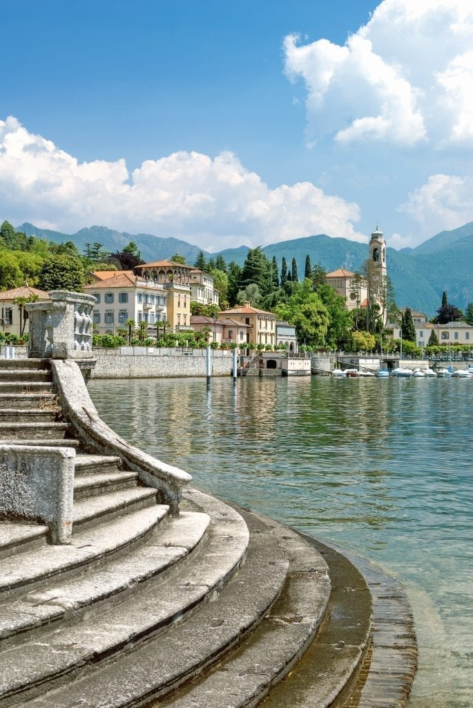 View of Lake Como with a staircase leading to the water in the foreground. Italy's lakes are part of one of the best road trips in Italy