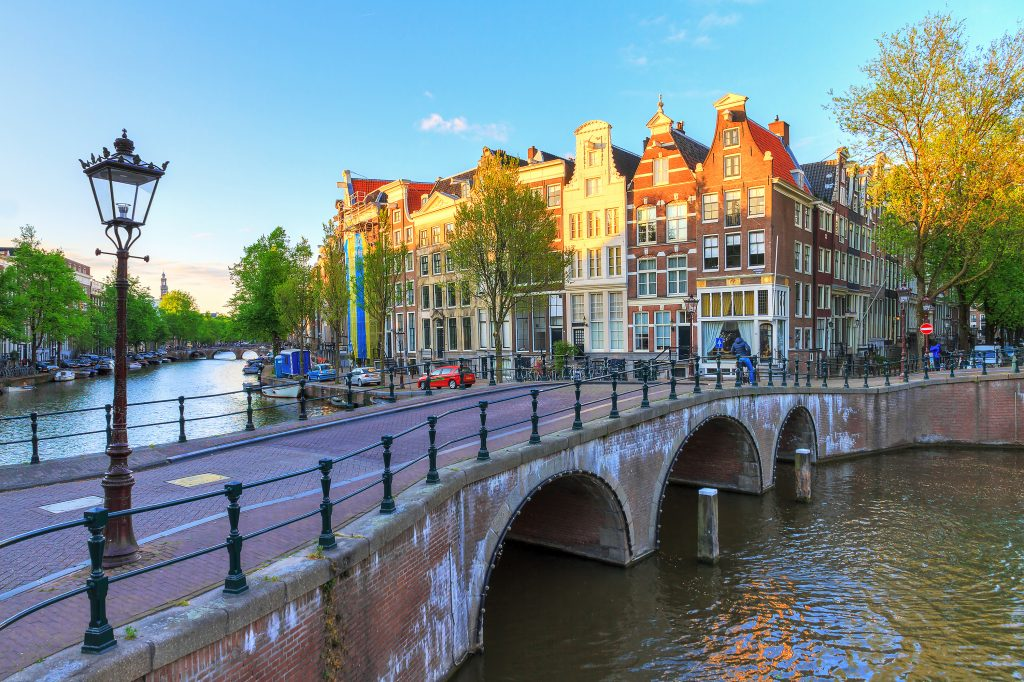 bridge leading over a canal amsterdam netherlands