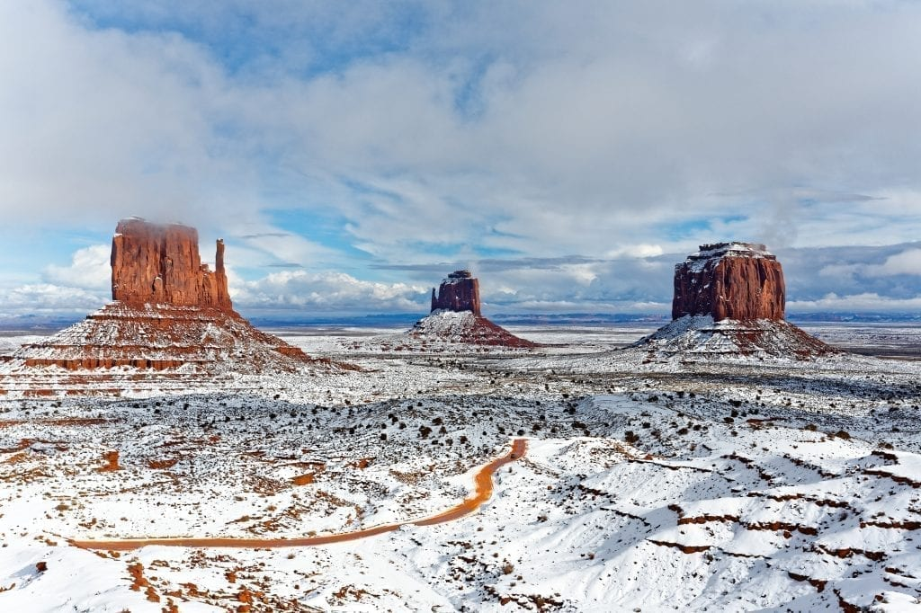 Monument Valley in winter with snow covered the ground and parts of the monuments