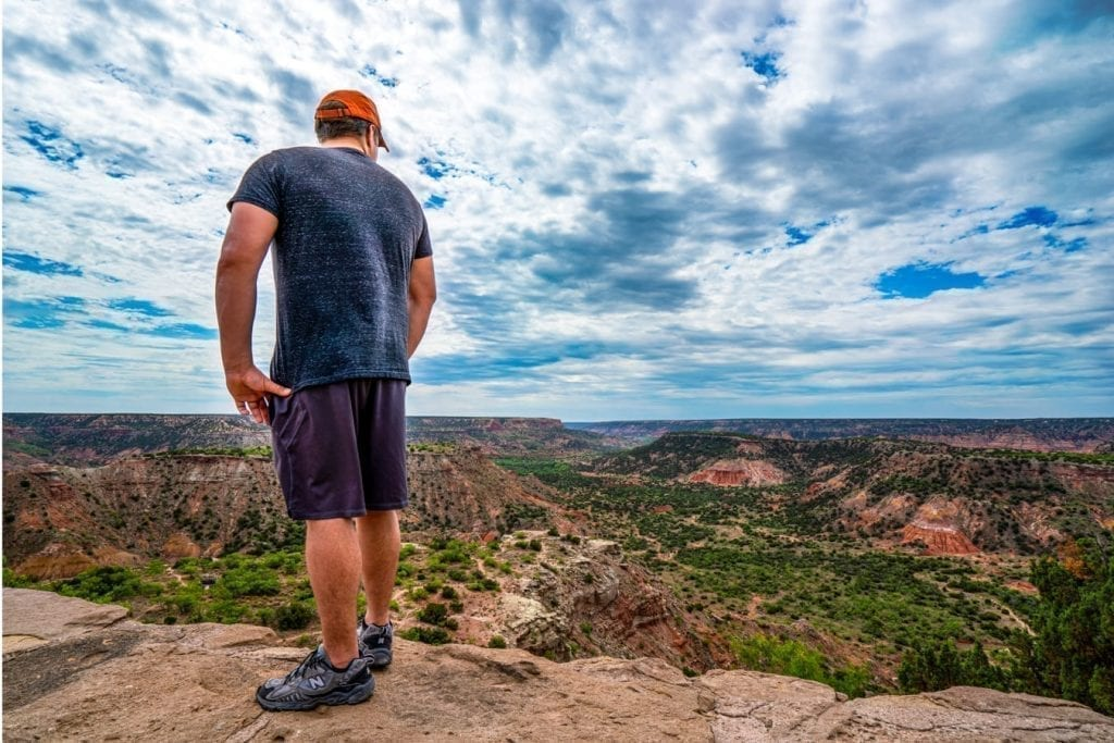 Jeremy Storm standing a ledge overlooking Palo Duro Canyon Texas as seen near the visitors center