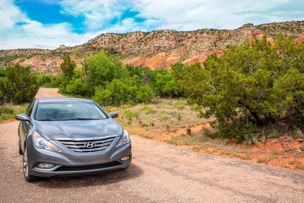 Gray Hyundai Sonata driving through Texas Palo Duro Canyon State Park