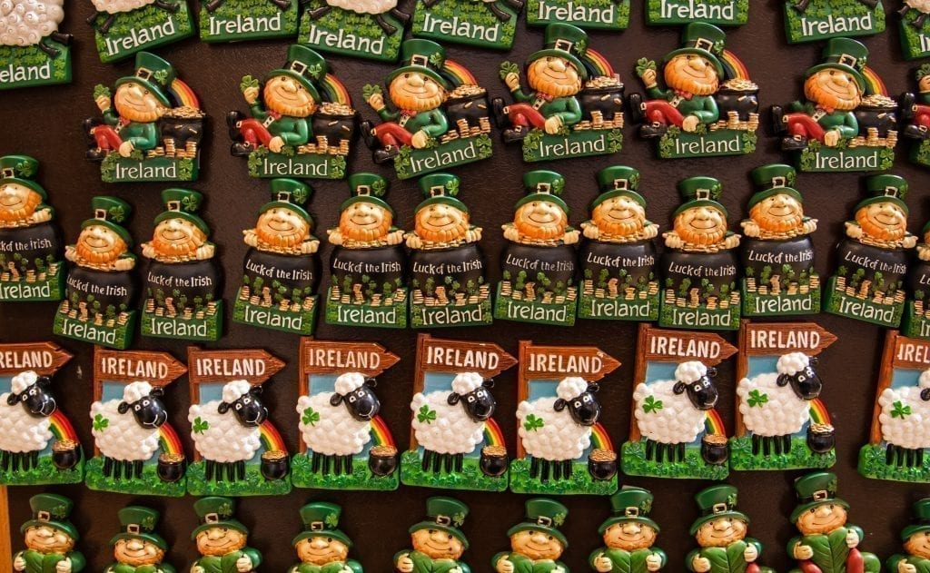 Collection of magnets in Ireland--a row of matching leprechaun magnets on top of a row of matching sheep magnets