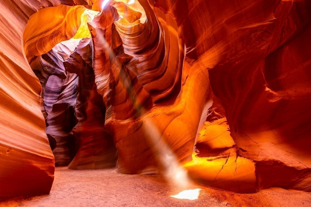 antelope canyon in arizona with a beam of light streaming into the canyon