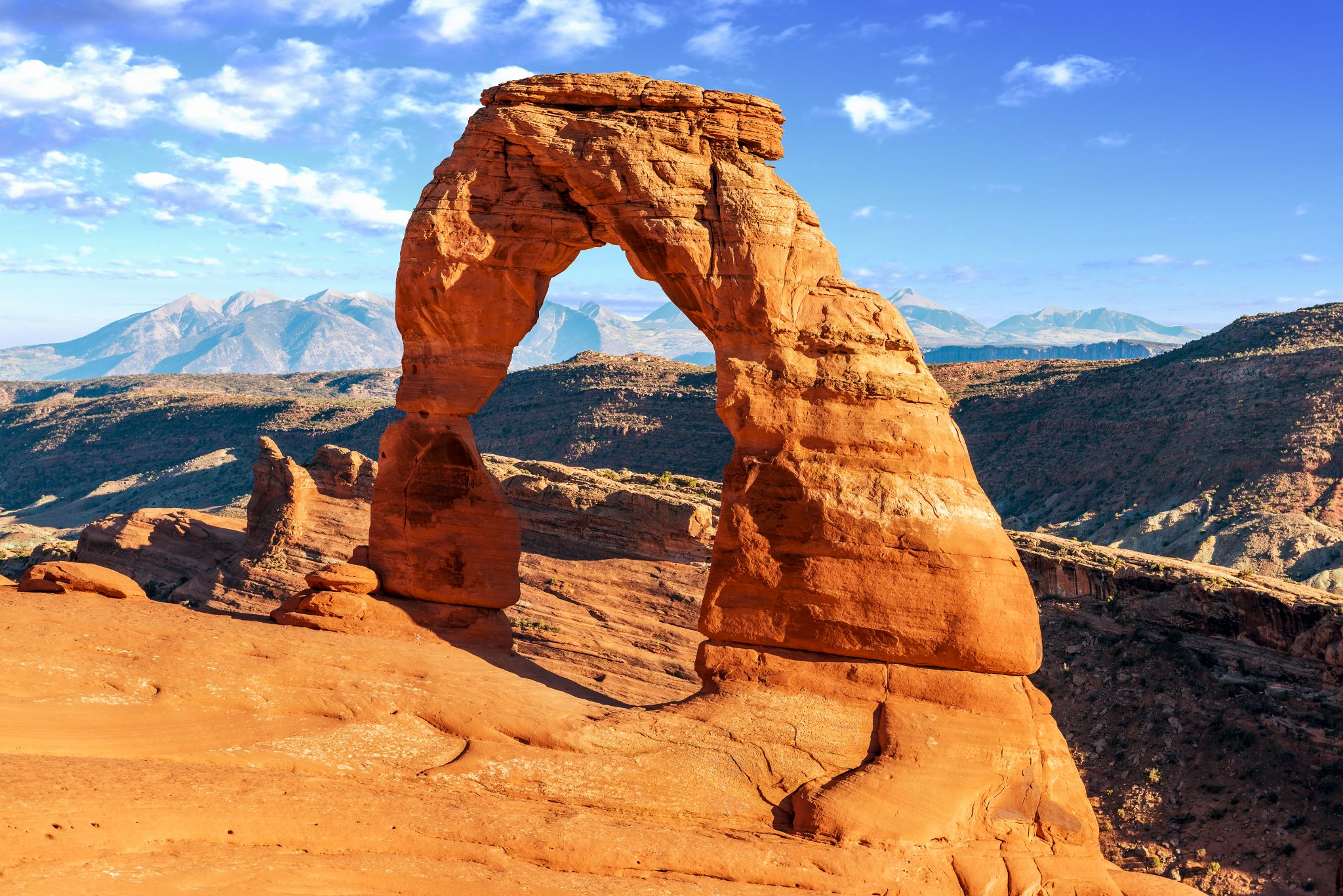 delicate arch on a sunny day, the view at the end of the delicate arch hike in arches national park