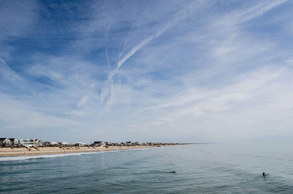 Beach on Topsail Island North Carolina, with the partly cloudy sky taking up most of the image