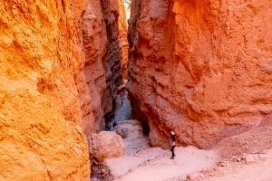 Kate Storm looking down into Wall Street Slot Canyon in Bryce Canyon, an unforgettable stop on a Utah road trip itinerary