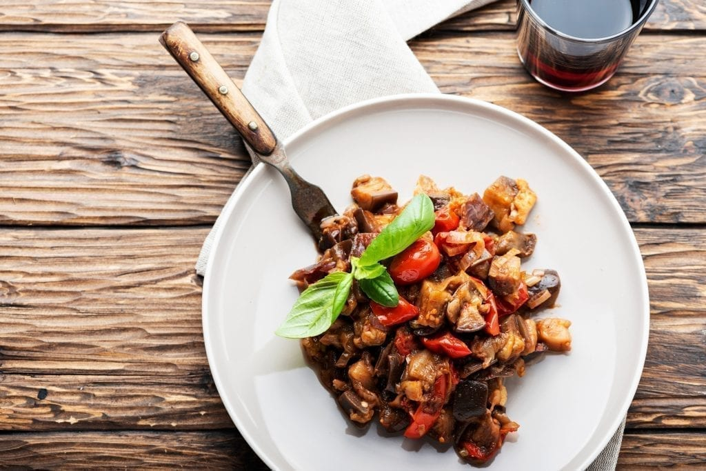 White plate of caponata, a traditional side dish in Sicily food