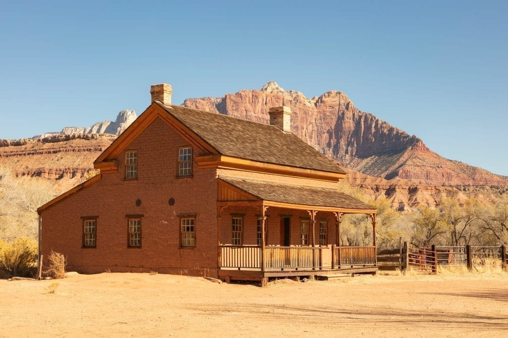 Wood building in Grafton Utah in front of a rock formation near Zion National Park