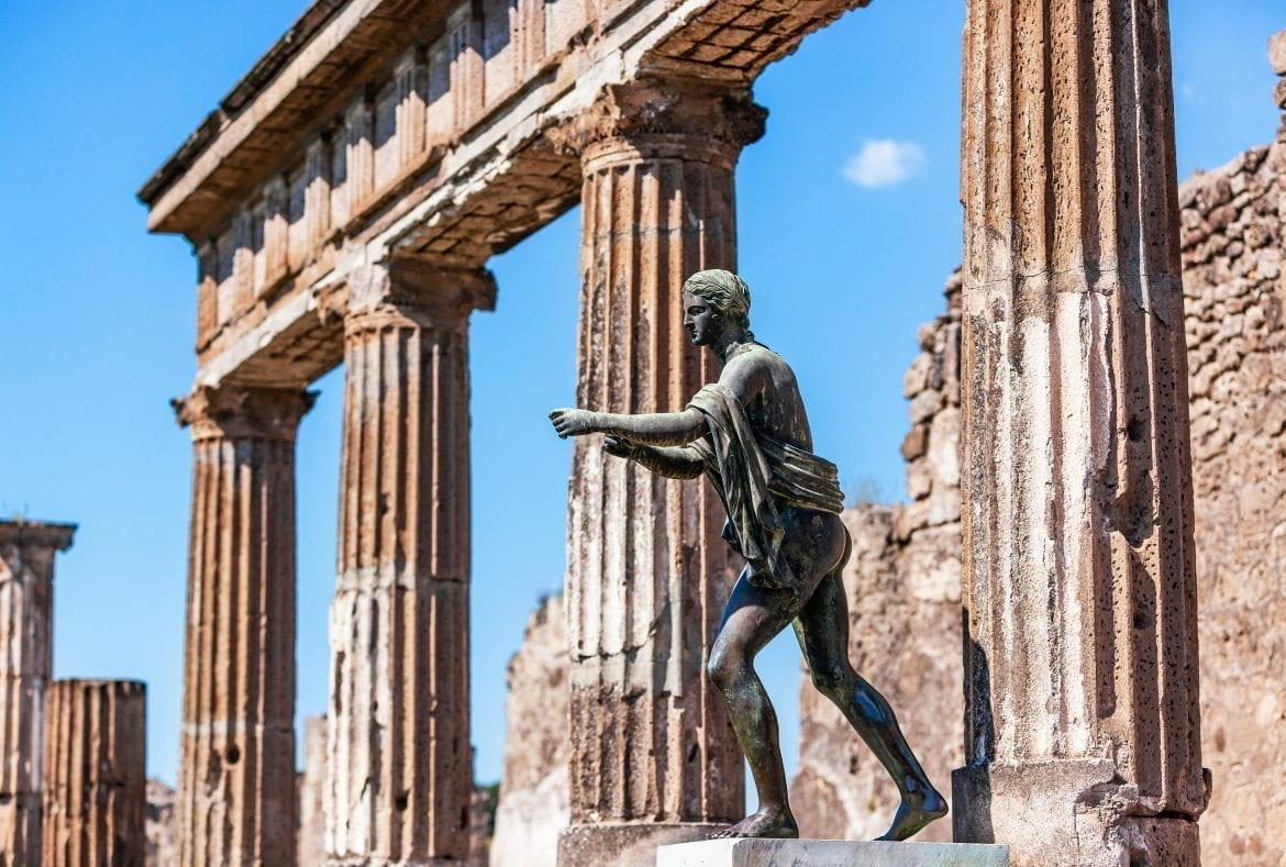 Statue of Apollo in front of the Temple of Apollo in Pompeii. Incredible ruins like this can be seen at either Pompeii or Herculaneum