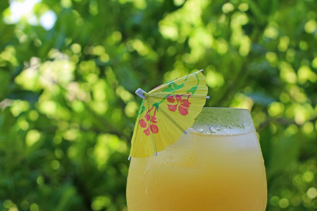 fresh orange juice with an umbrella in it, one of the popular breakfast foods in mexico