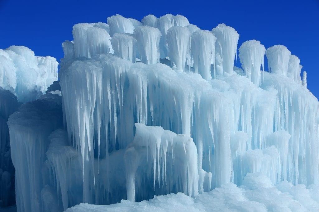 Ice Castle in Utah under a blue sky
