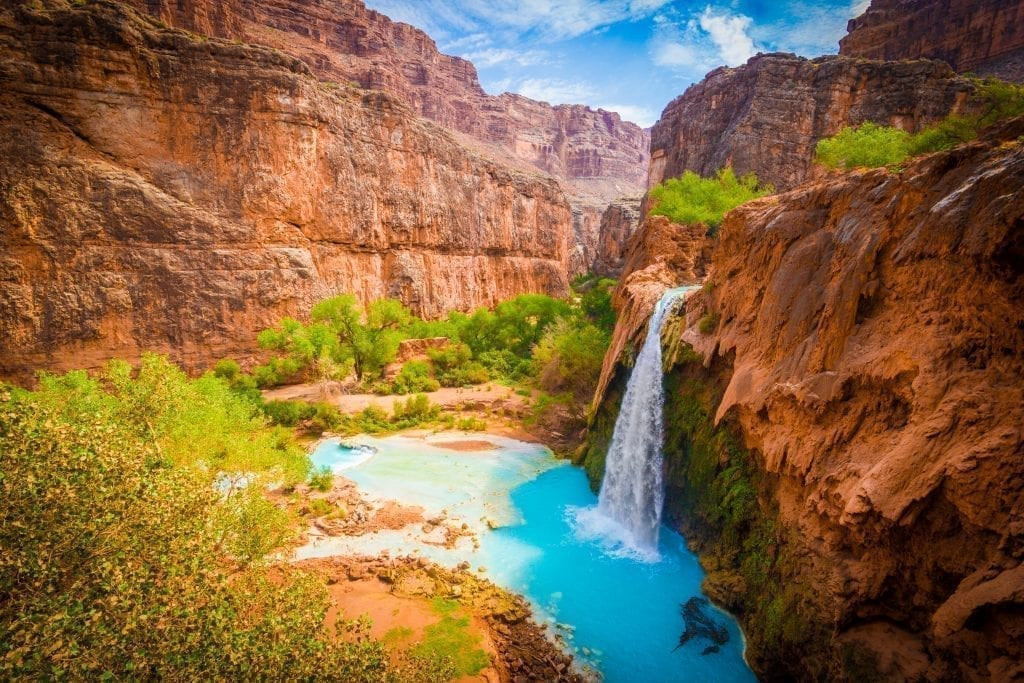 Havasu Falls in Arizona, one of the most beautiful places in USA. Turquoise waterfall with orange walls surrounding it