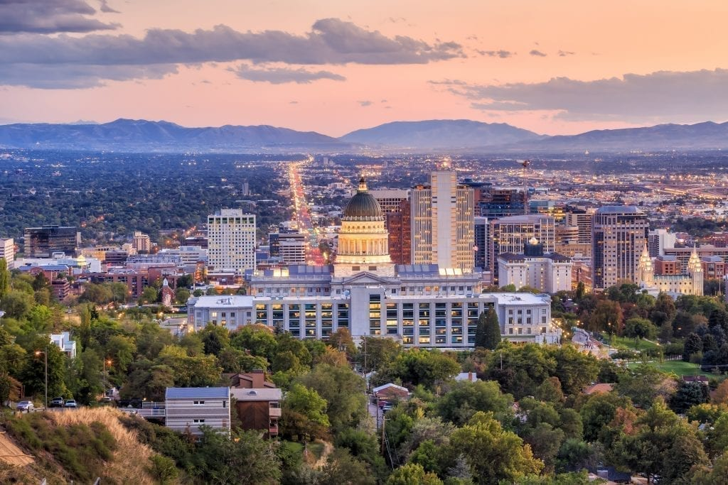 Skyline of Salt Lake City at sunset with the Utah Capitol Building in the center. Salt Lake City is one of the best cities to visit in Utah