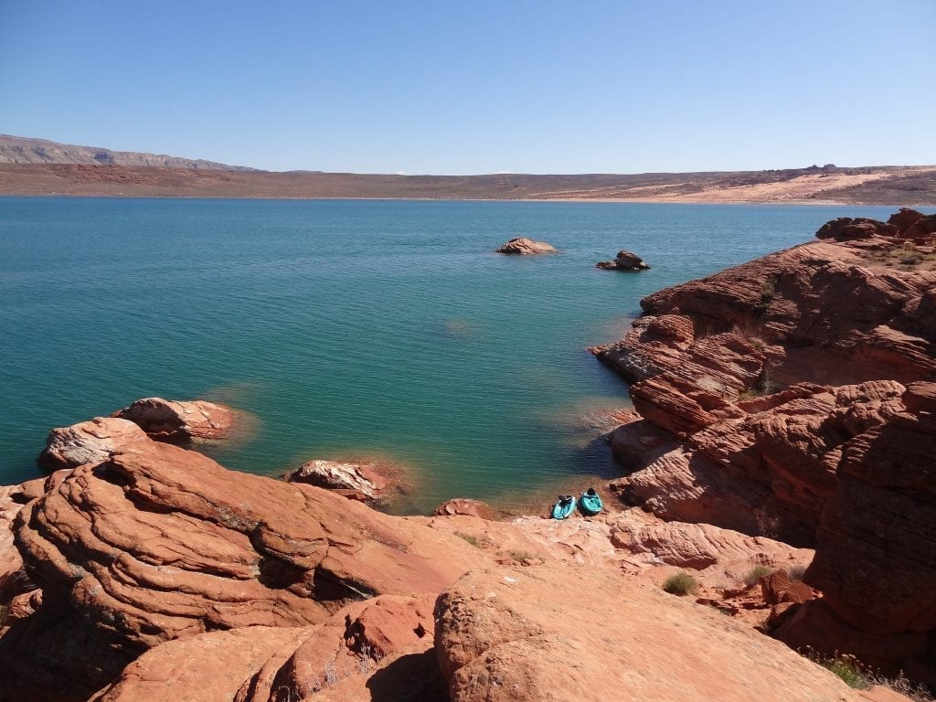 Lake surrounded by red rock in Sand Hollow State Park, one of the best places to see in Utah