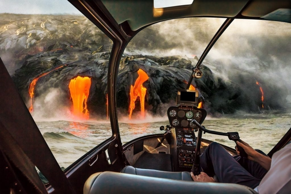 Helicopter tour of Volcano National Park in Hawaii shot from inside the helicopter with lava visible through the windshield
