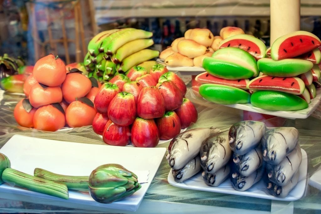 Marzipans shaped as fruits and vegetables in a shop window