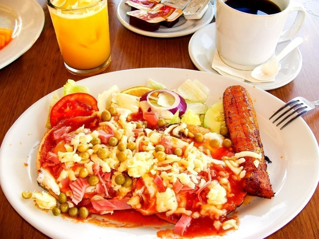 Huevos motulenos on a white plate, a typical Mexican breakfast in the yucatan