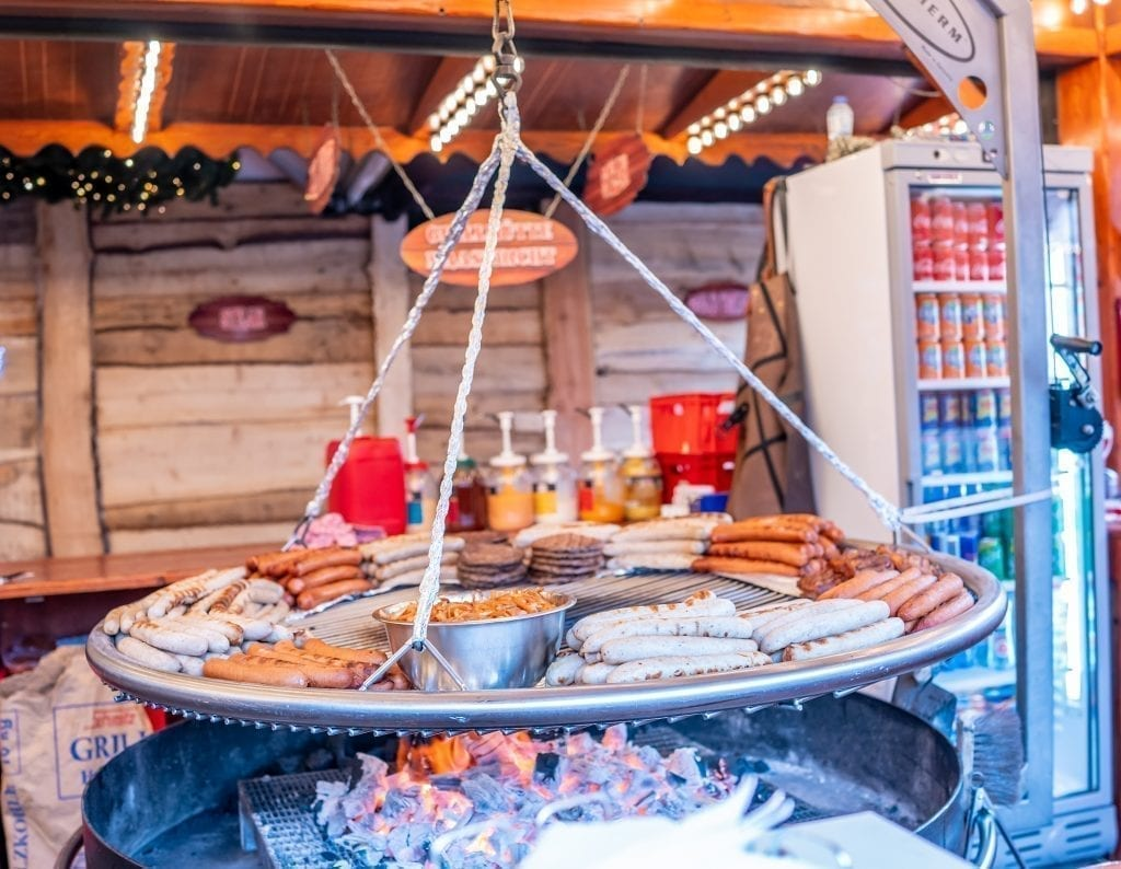 Sausages being grilled at a stall at a European Christmas market