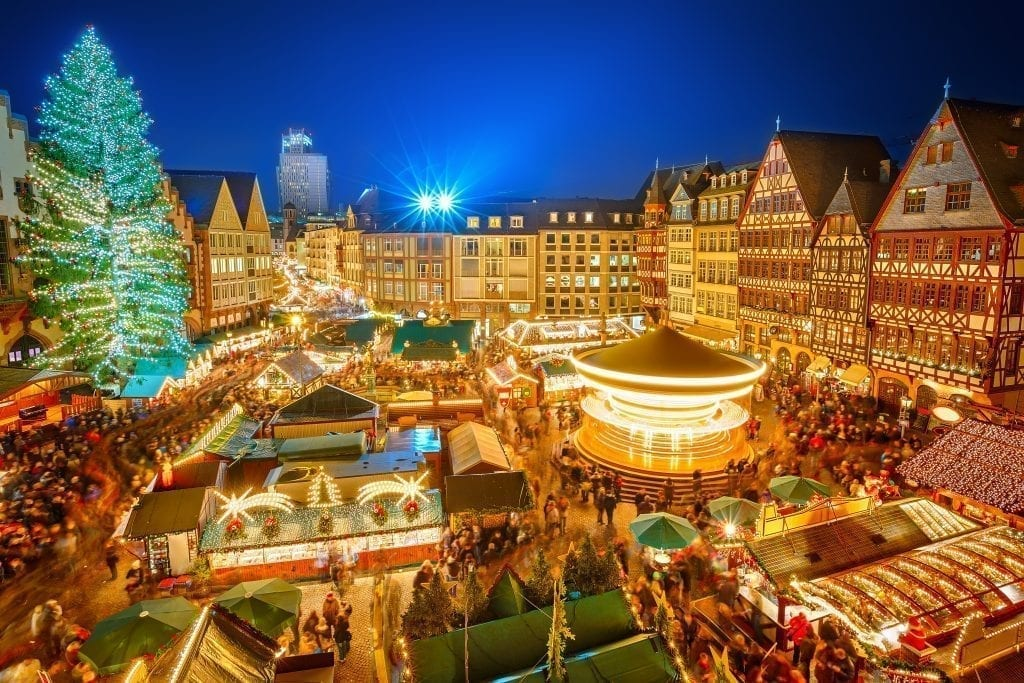 View of one of the best Christmas markets europe has to offer in Frankfurt as seen from above during blue hour