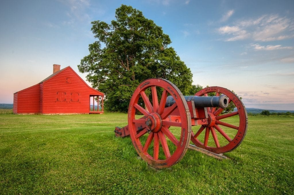 Historic red farmhouse and cannon near Saratoga NY, one of the best weekend trips from boston MA
