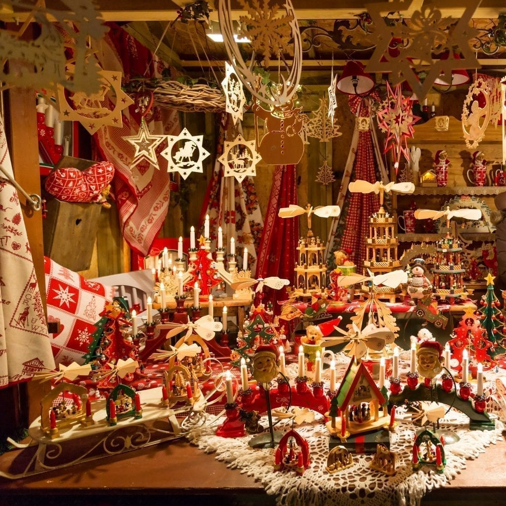 Photo of wooden ornaments and other holiday decor for sale at one of the Christmas markets in France